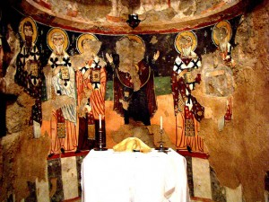 Fathers of the Church as well as the Virgin of the Sign depicted in the apse behind the altar.