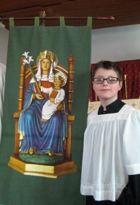 Thomas, is the official bearer of Our Lady of Walsingham's banner at the Fellowship of Saint Alban.