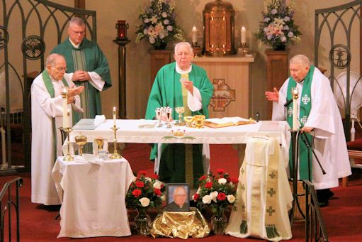 Fr. Frederick Eisemann celebrates Mass in thanksgiving for his 60 years in the priesthood. Concelebrating are Frs. John Reif and Thomas Wheeland, with Dcn. Ed Giblin assisting.